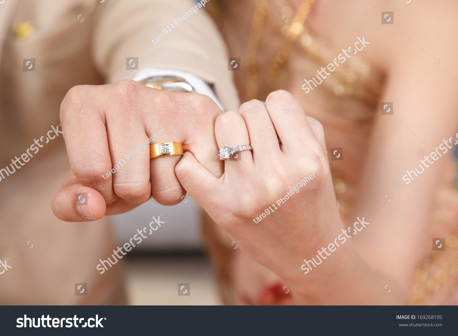 Bride And Groom Wear Wedding Ringshook Each Others Little Finger