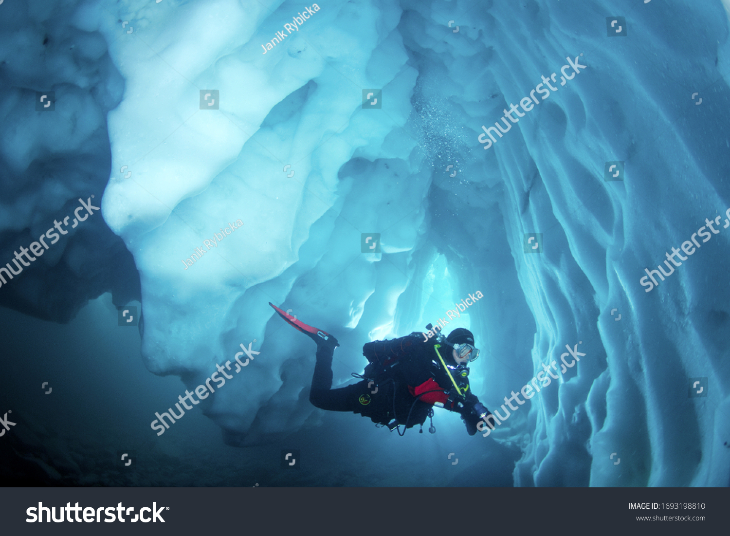 Cool adventure scuba diving in ice cave. Underwater world. #1693198810