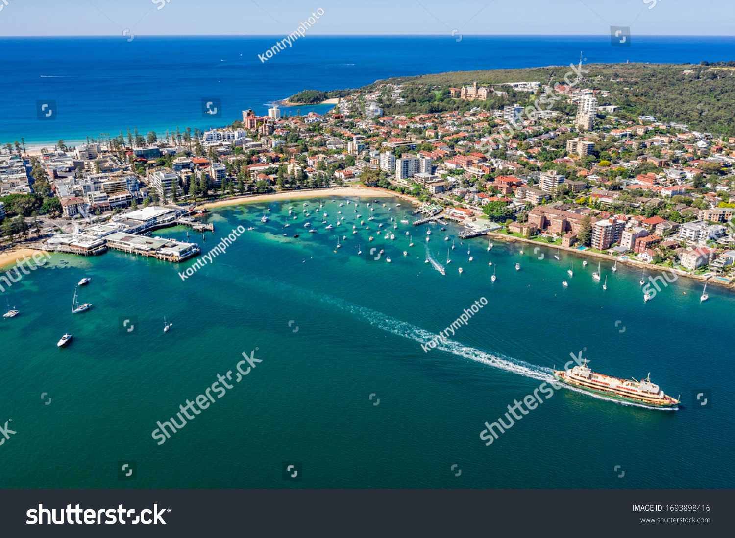 Aerial view on famous Manly Wharf and Manly, Sydney, Australia. View on Sydney harbourside suburb from above. Aerial view on Sydney North Harbour, Manly and Manly Wharf. #1693898416