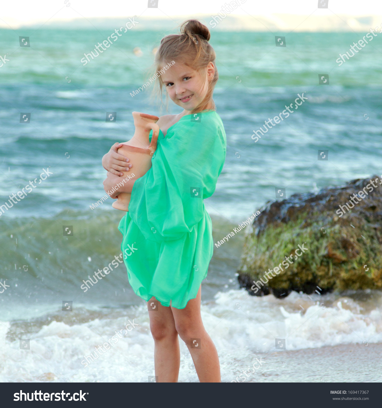 Happy Beautiful Natural Emotion Woman Joying On Blue Sea: Greek Smiling Little Girl Tunic Holds Stock Photo