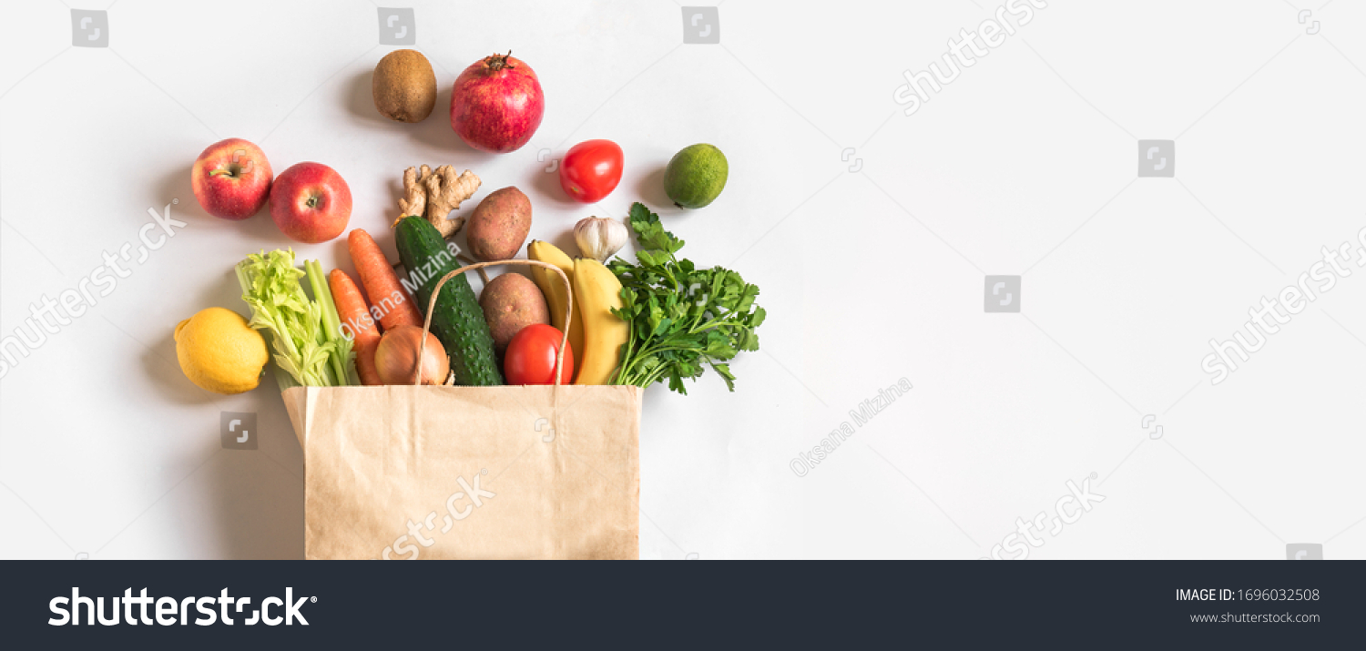 Delivery healthy food background. Vegan vegetarian food in paper bag vegetables and fruits on white, copy space, banner.Grocery shopping food supermarket and clean vegan eating concept. #1696032508