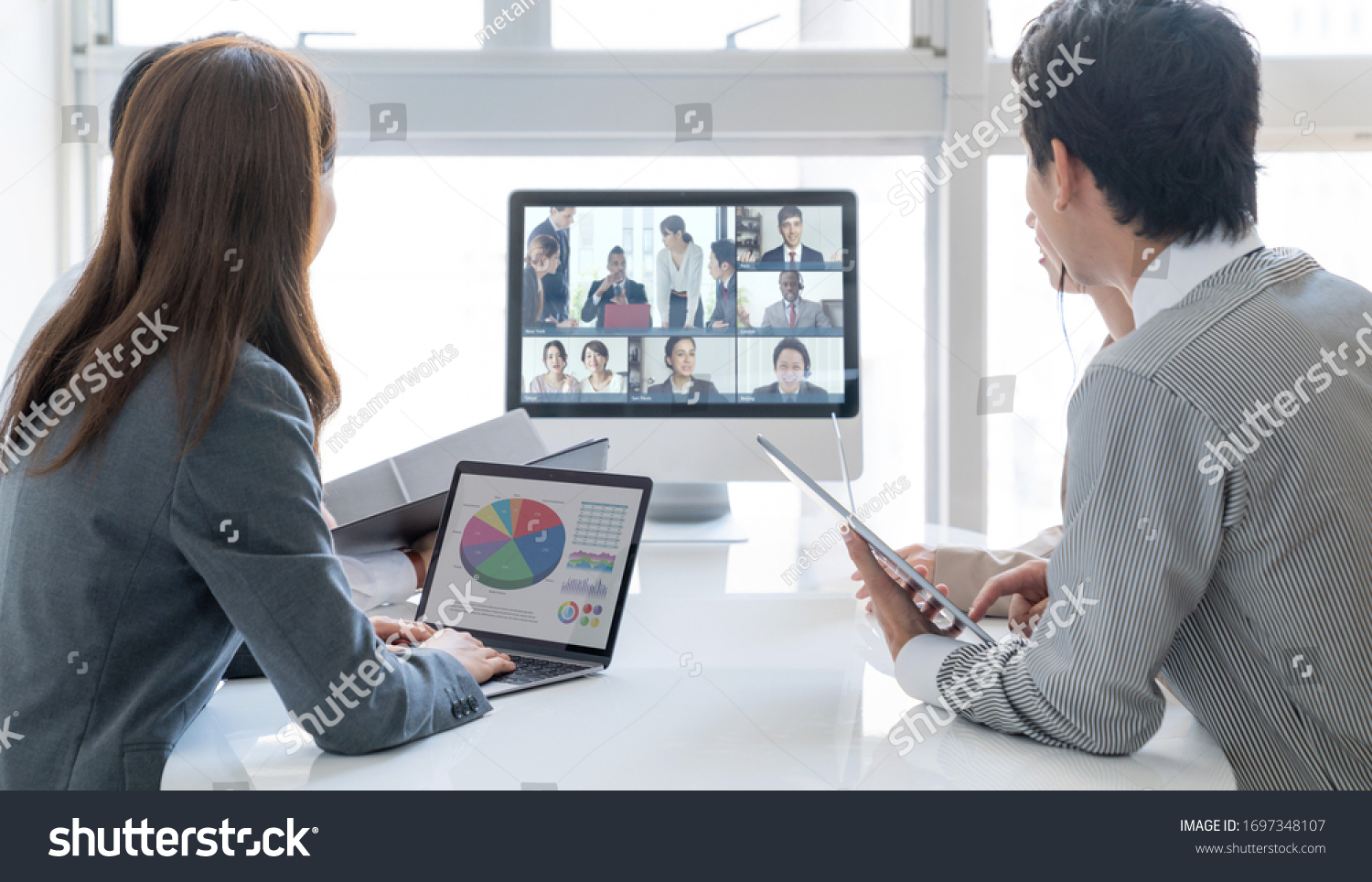 Video conference concept. Telemeeting. Videophone. Teleconference. #1697348107