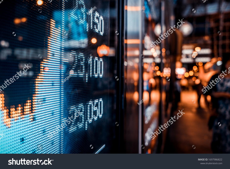 Financial stock exchange market display screen board on the street, selective focus #1697986822