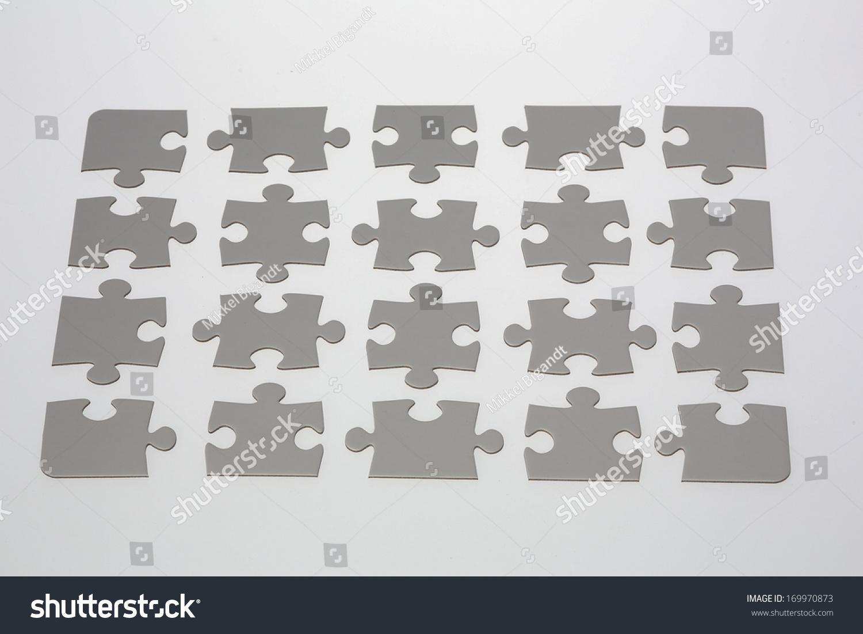 20 jigsaw puzzle pieces placed on illuminated white background. | EZ ...