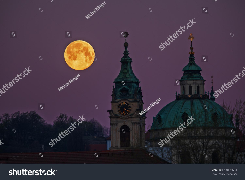 super full moon  super full moon above the church of St. Nicholas in Prague