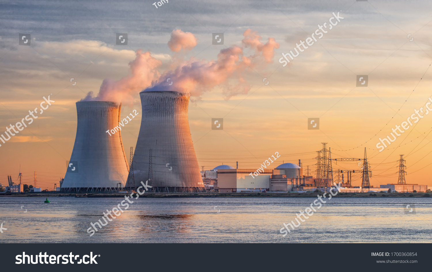 Late afternoon scene with view on riverbank with nuclear reactor Doel, Port of Antwerp, Belgium. #1700360854