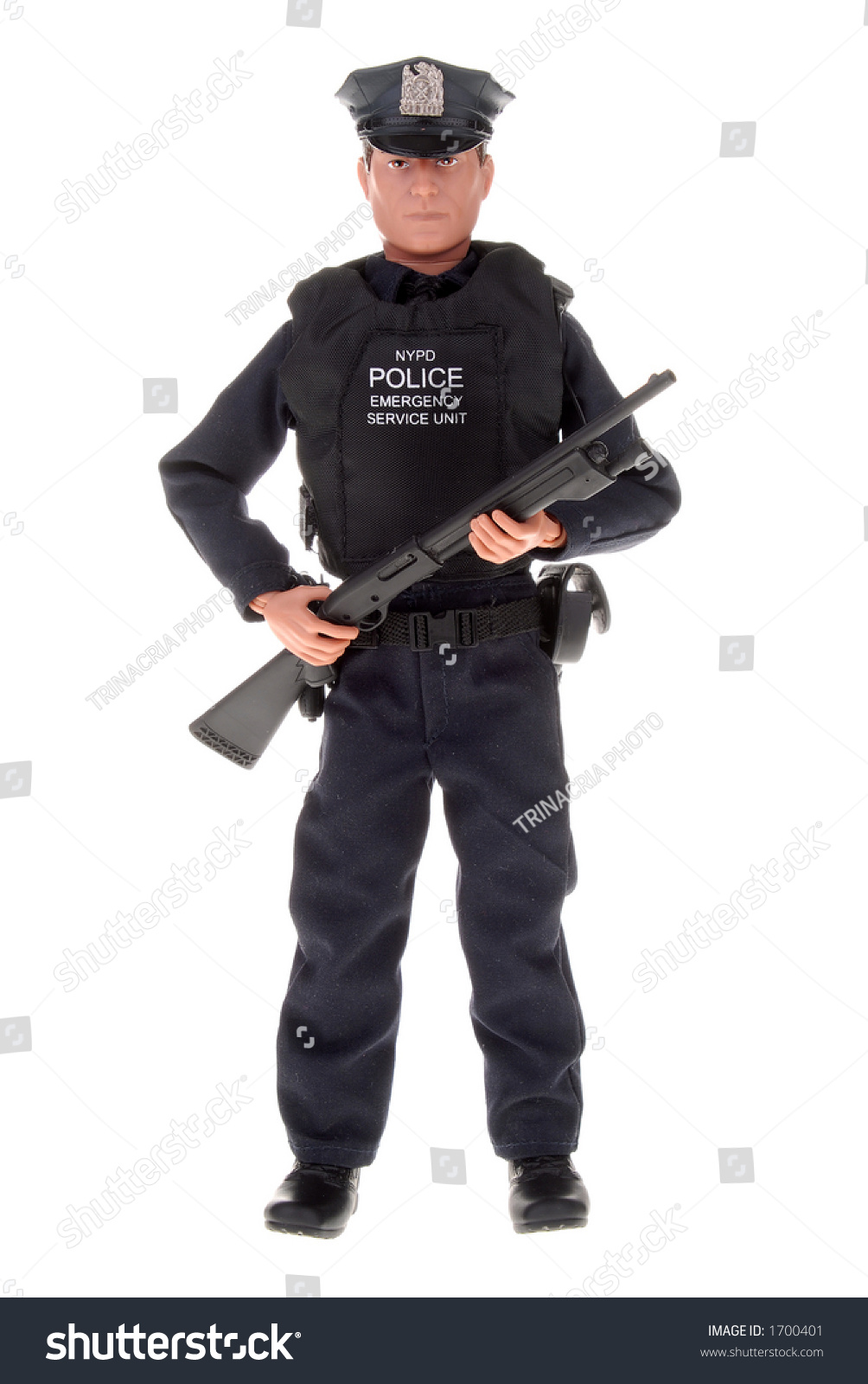 Plastic Toy Police Officer Doll With A Shotgun Stock Photo
