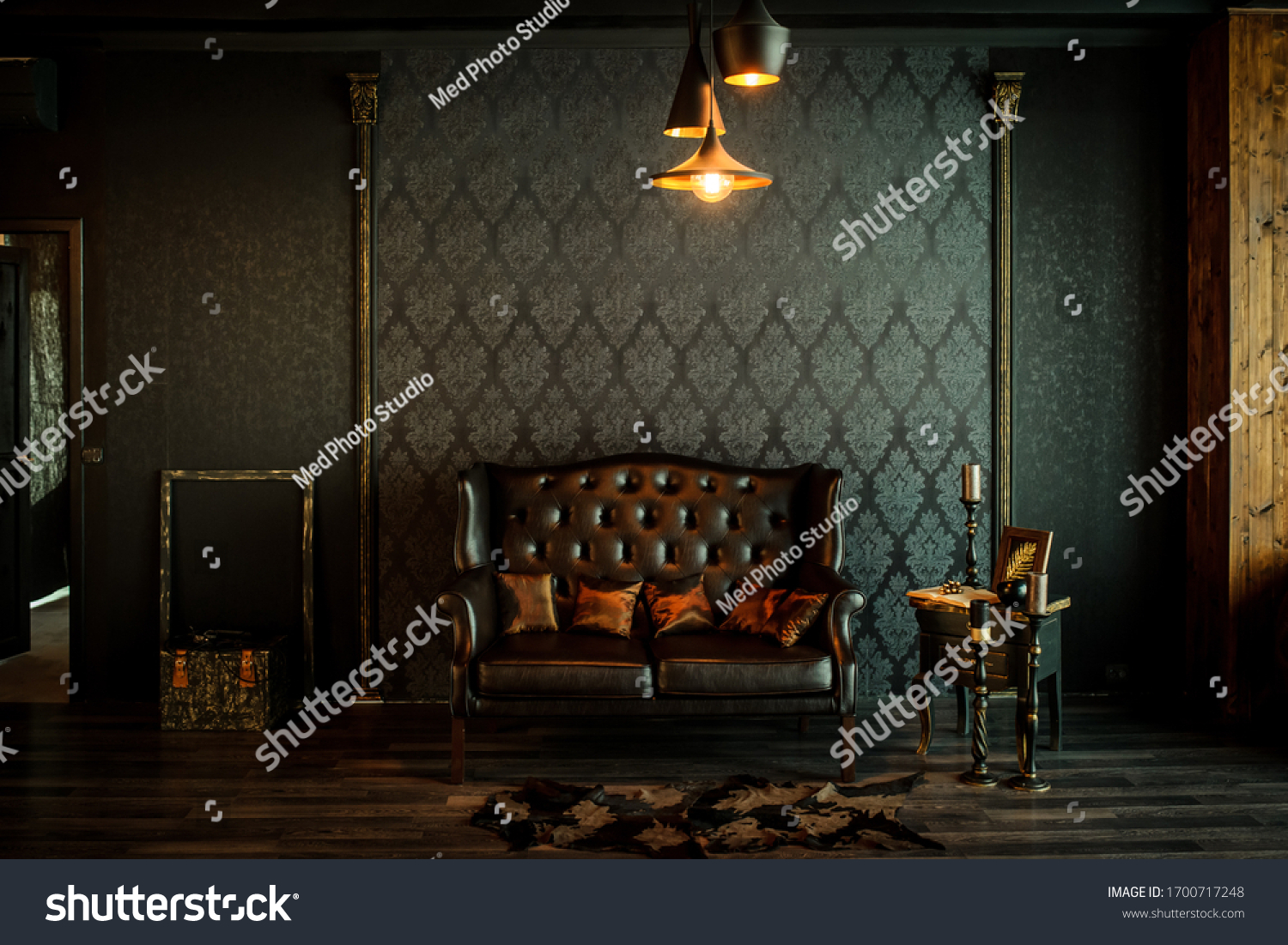 Old vintage interior with leather sofa, wood table and ceiling light. #1700717248