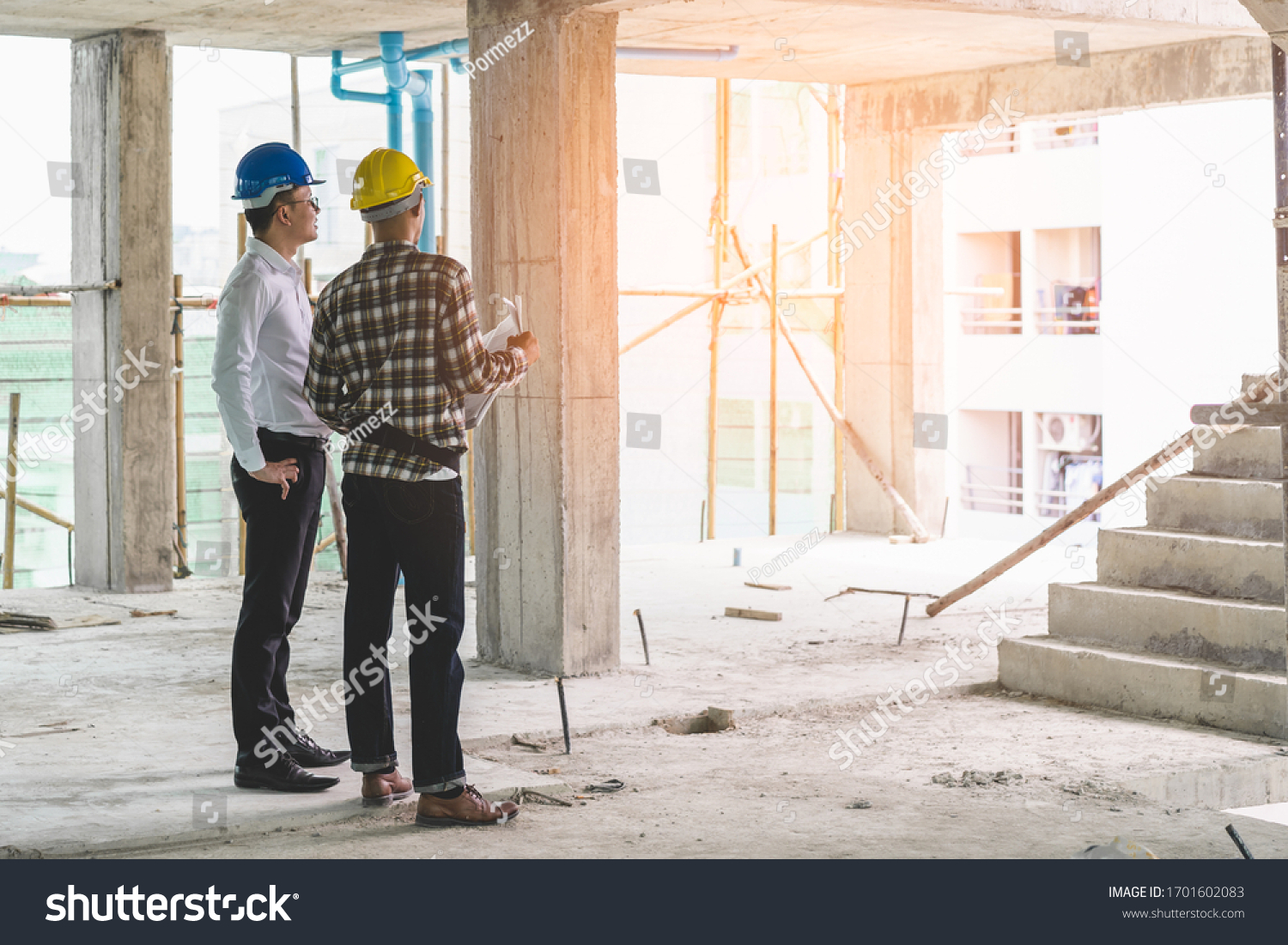 Asian contractor and engineer inspecting material in construction building. #1701602083