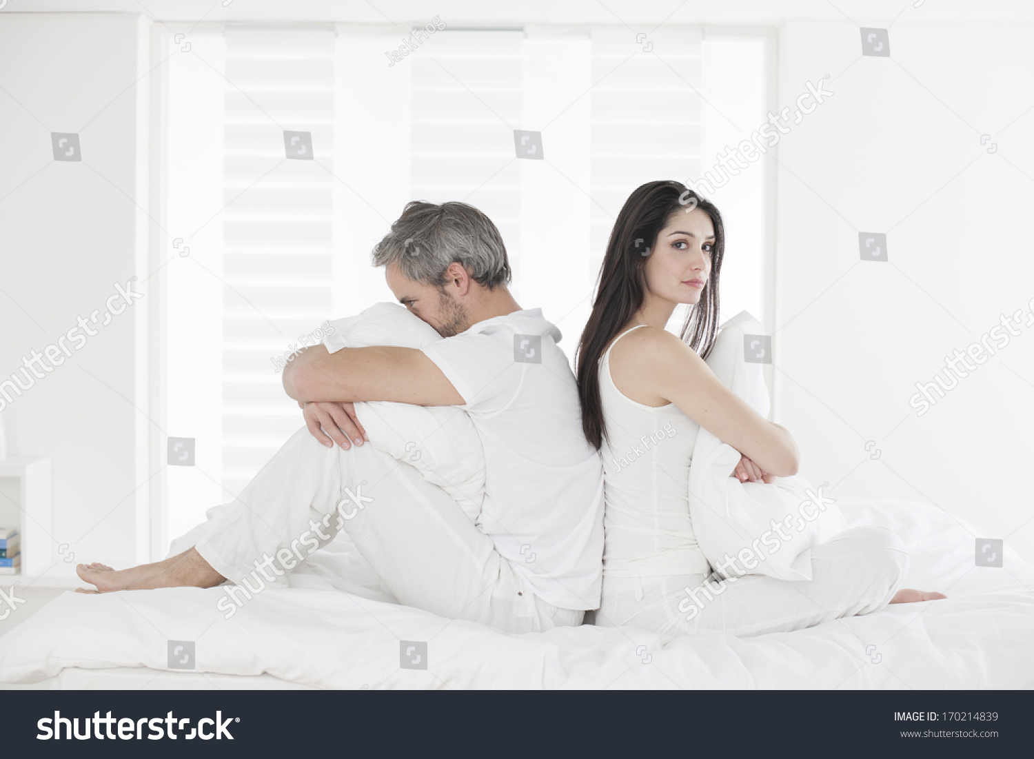 Unhappy Couple Ignoring Each Other Sitting Stock Photo (Edit
