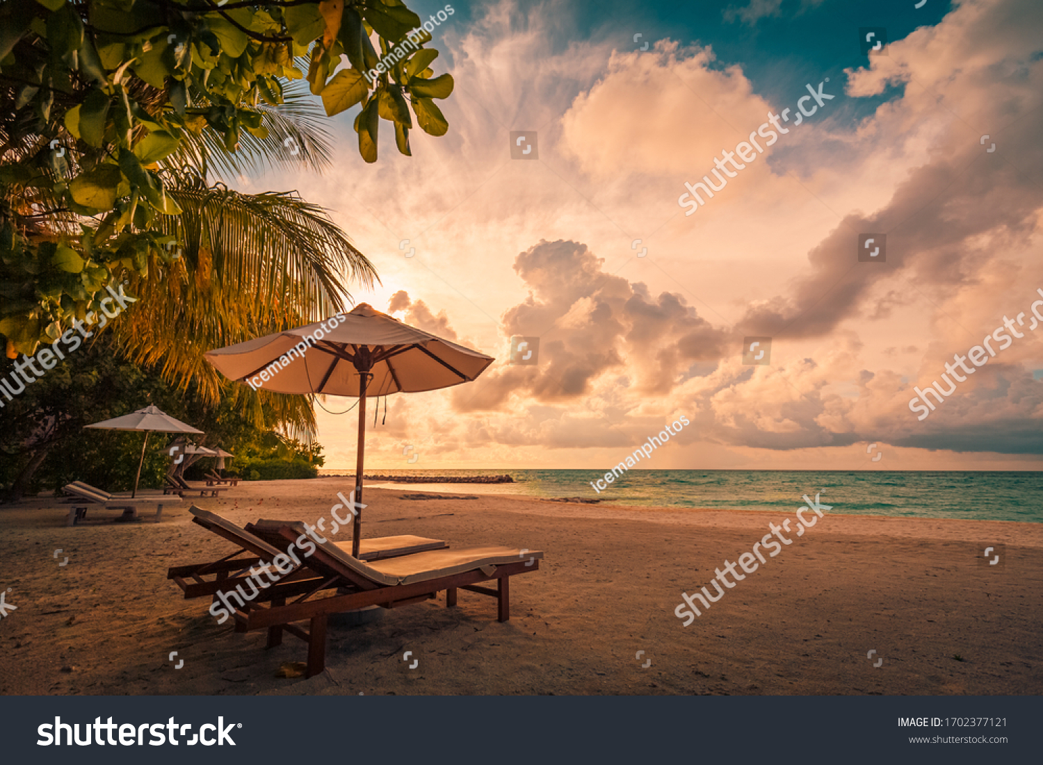 Beautiful beach. Chairs on the sandy beach near the sea. Summer holiday and vacation concept for tourism. Inspirational tropical landscape. Tranquil scenery, relaxing beach, tropical landscape design #1702377121