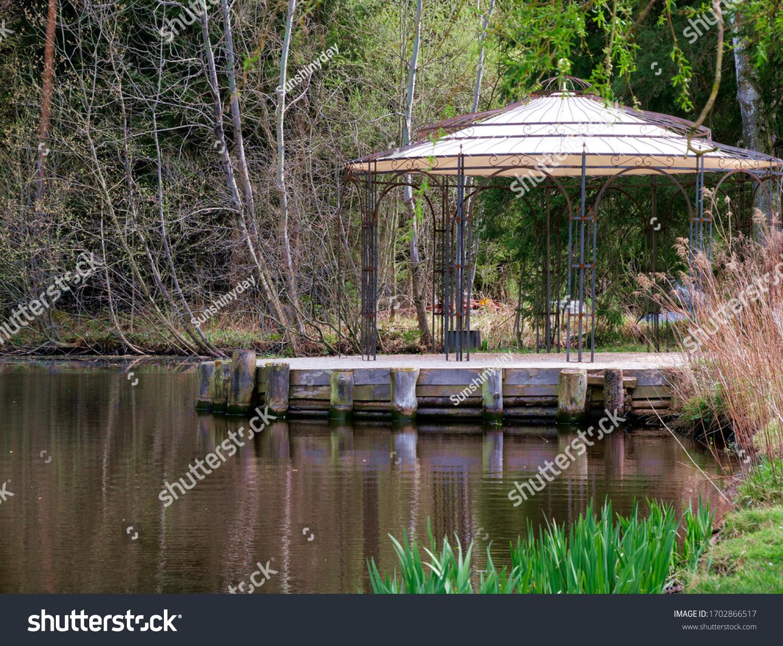 Romantic pavilion on a quiet pond