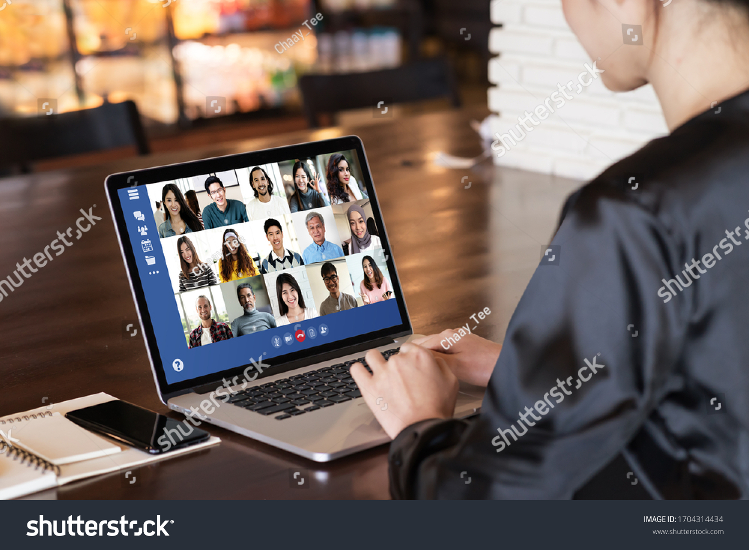 Back view of young asian business woman work remotely at home video conference remote call to corporate group. Meeting online,videocall, group discuss online concept with screen of teamwork on laptop. #1704314434