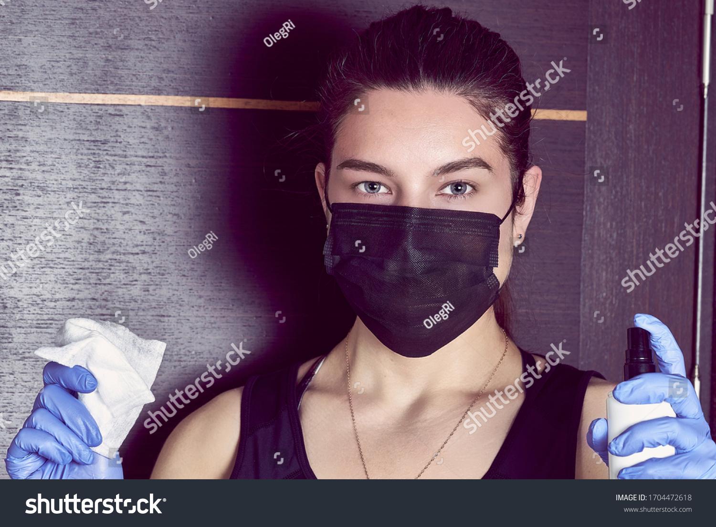 Coronavirus. Woman in quarantine for coronavirus wearing protective mask and plastic gloves. #1704472618