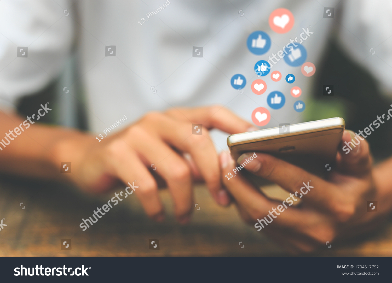 Young man using smart phone,Social Distancing ,Working From Home concept.  #1704517792