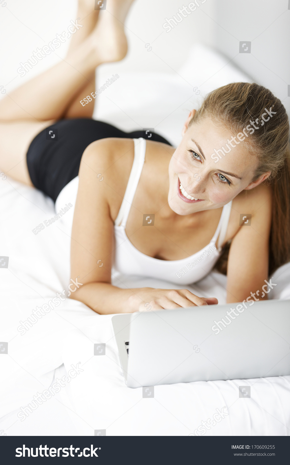 Friends Lying On Bed With Long Hair