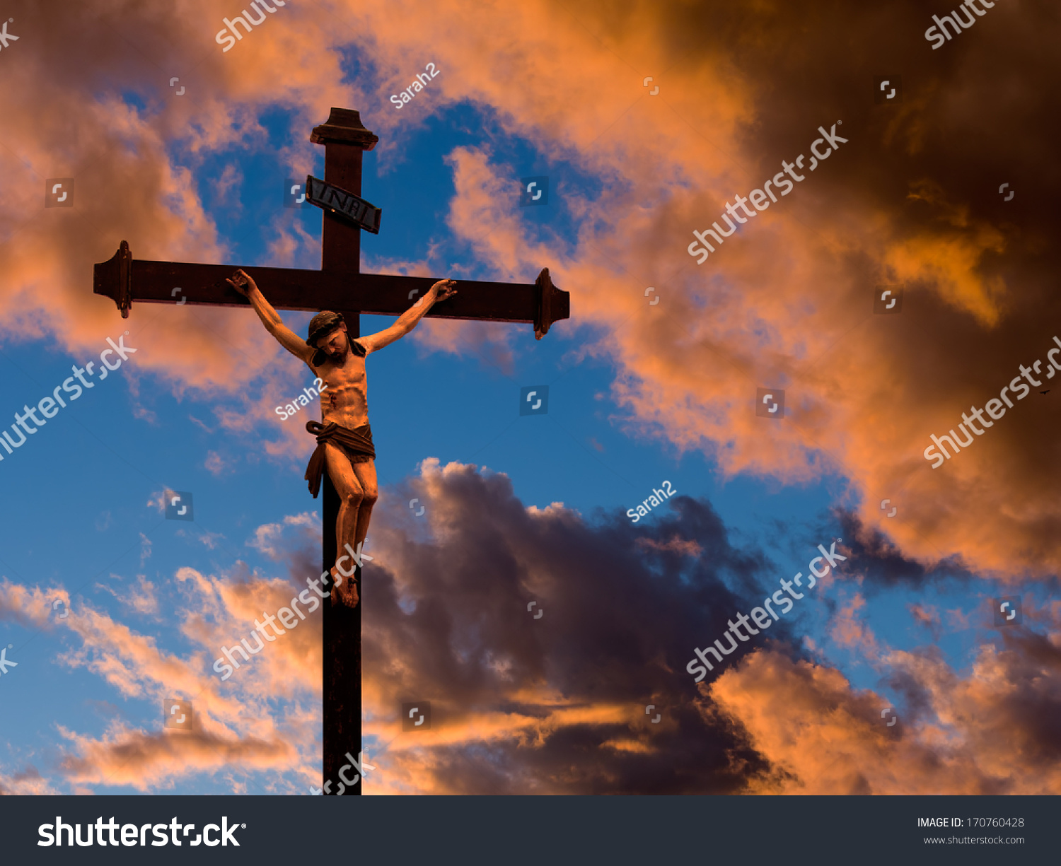Silhouette of the holy cross on background of storm clouds stock - Save To A Lightbox