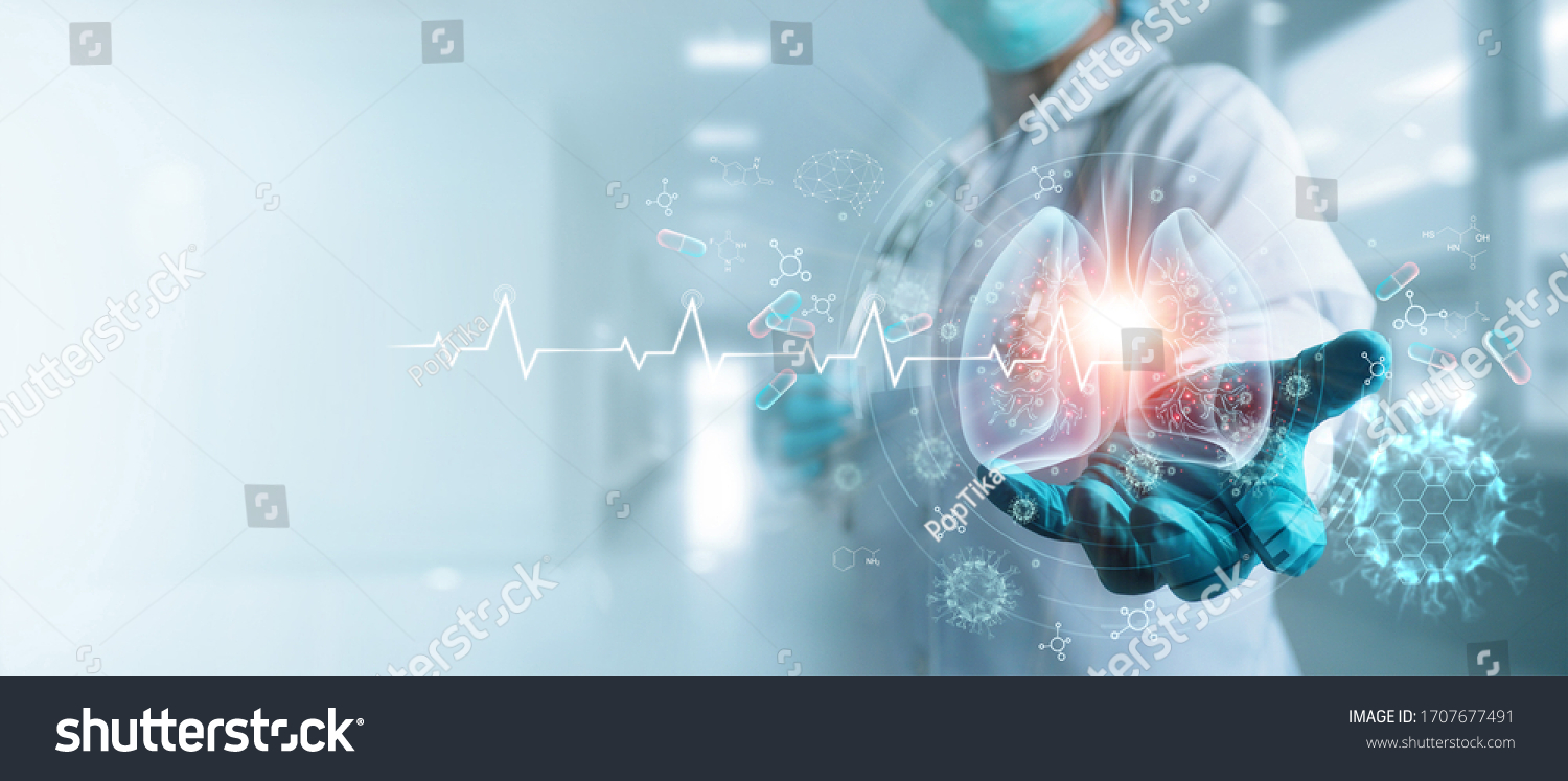 Healthcare and medicine, Covid-19, Doctor holding and diagnose  virtual Human Lungs with coronavirus spread inside on modern interface screen on hospital background, Innovation and Medical technology. #1707677491