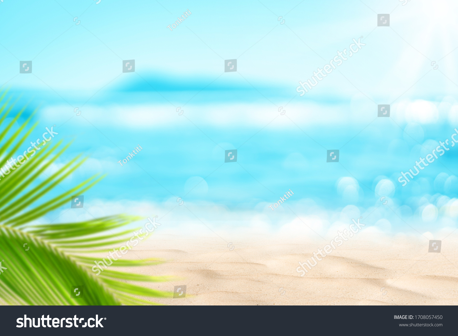 Blur beautiful nature green palm leaf on tropical beach with bokeh sun light wave abstract background. Copy space of summer vacation and business travel concept. Vintage tone filter effect color style #1708057450