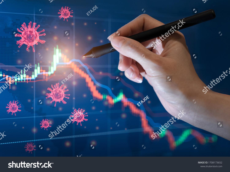 Coronavirus impact global economy stock markets financial crisis concept, Hand s' businessman show coronavirus or covid-19 sinks global stock exchanges. Graphs representing stock market crash caused   #1708173652