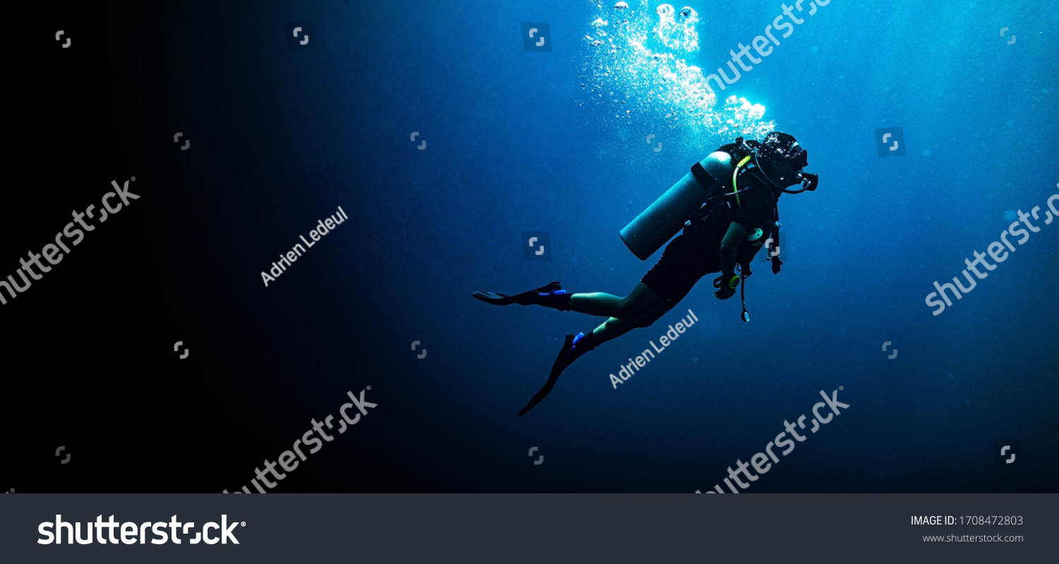 Woman scuba diving in deep blue sea banner on black background #1708472803