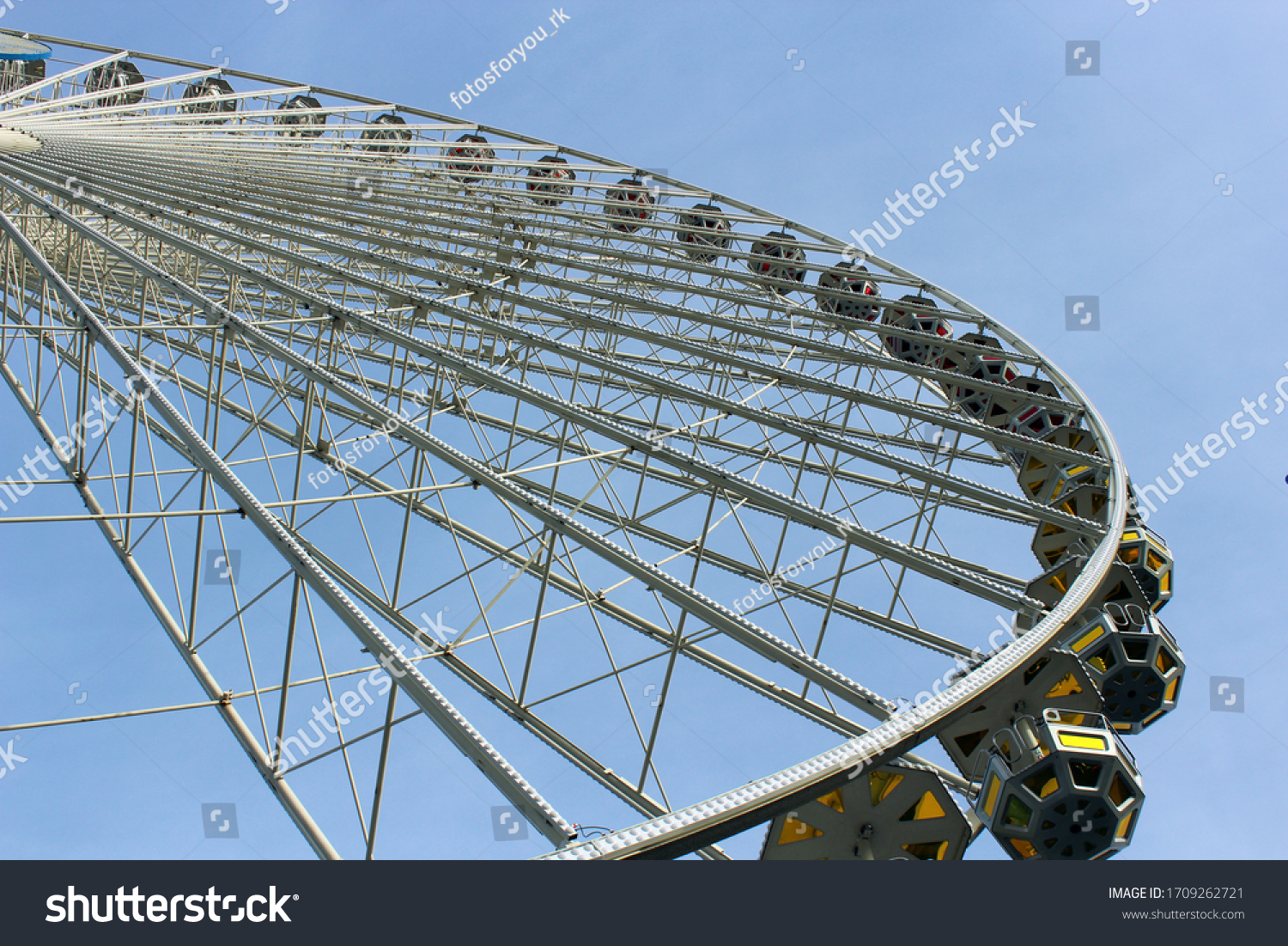 Ferris wheel in cologne against a blue sky