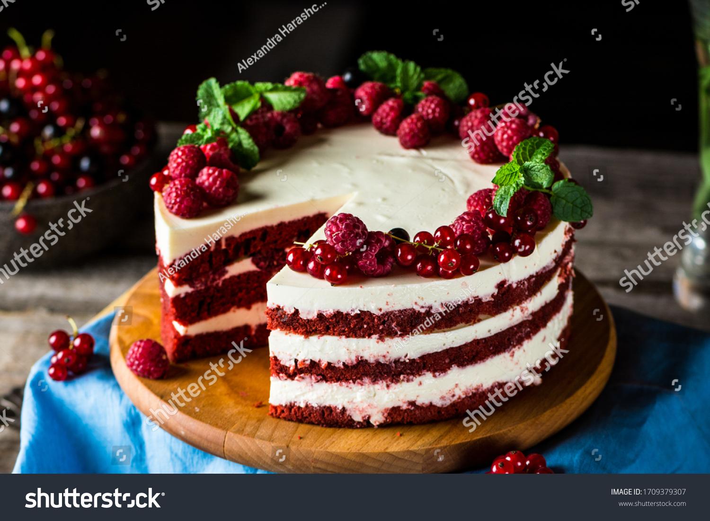Red velvet cake on wood board. Slice of cake. Raspberry cake. Devil's cake. Wedding dessert. Birthday party. Delicious dessert. Traditional american dessert #1709379307