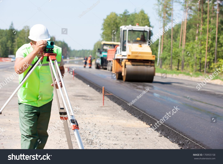 Engineering Measuring Instruments : Surveyor engineer worker making measuring theodolite stock