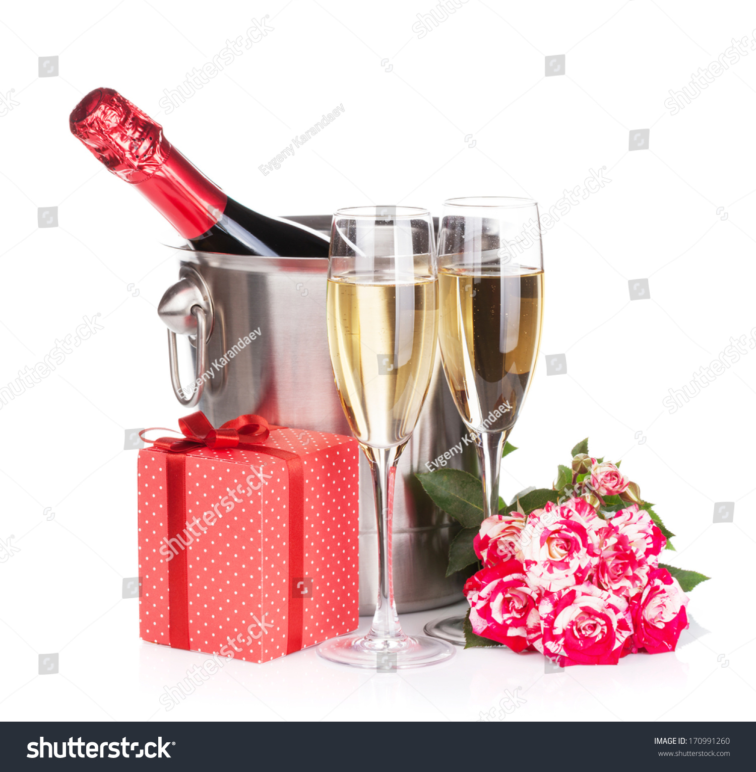 Champagne Bottle Two Glasses Gift Box And Red Rose Flowers