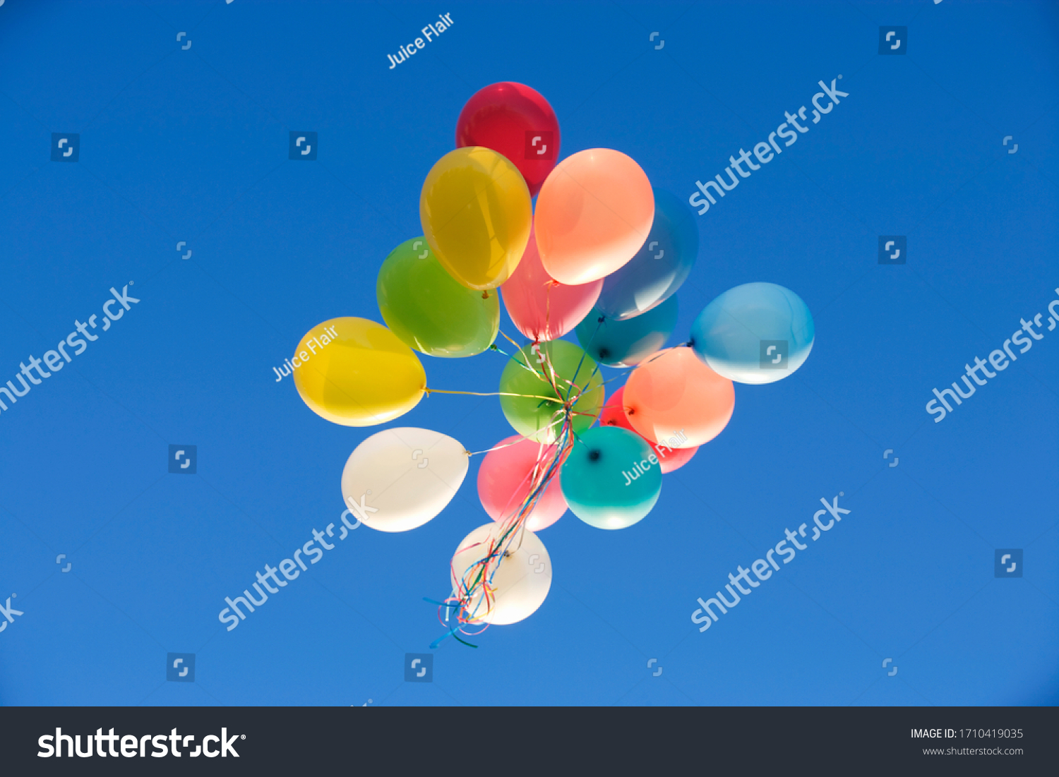 A bunch of balloons floating away #1710419035