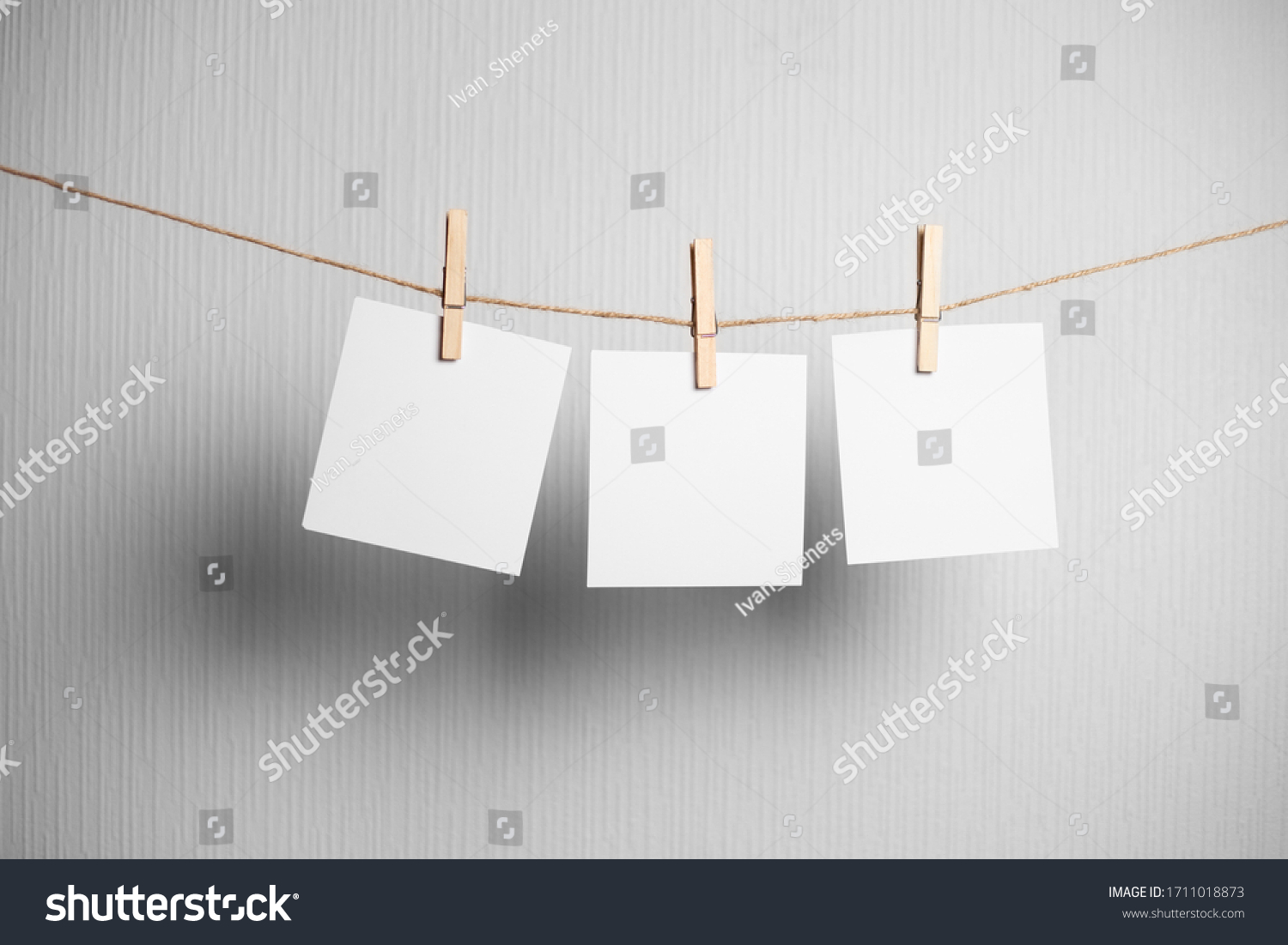 polaroid frame.Retro photo frames hanging on rope isolated on white background. real photo. three frames #1711018873