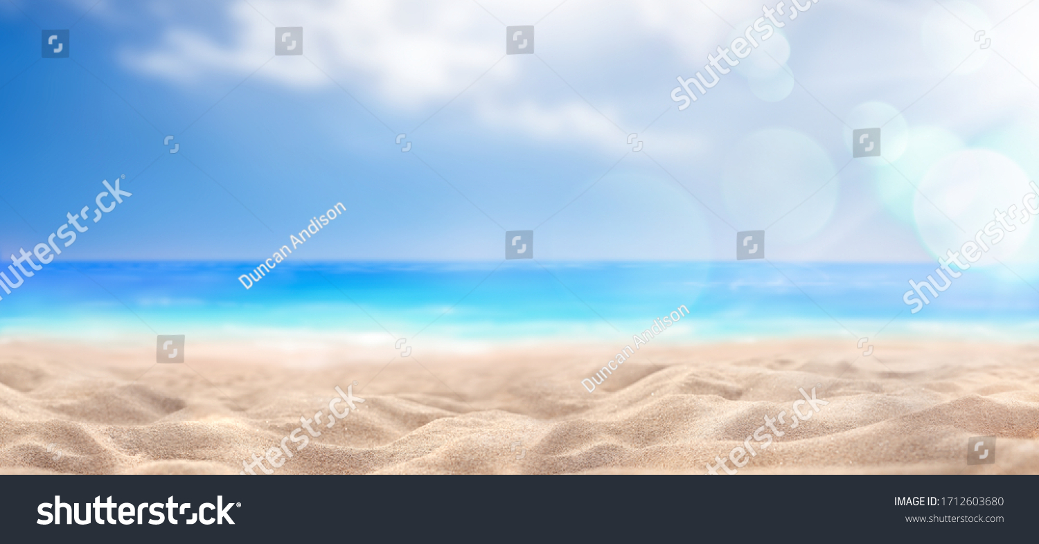 A summer vacation, holiday background of a tropical beach and blue sea and white clouds with sun flare. #1712603680