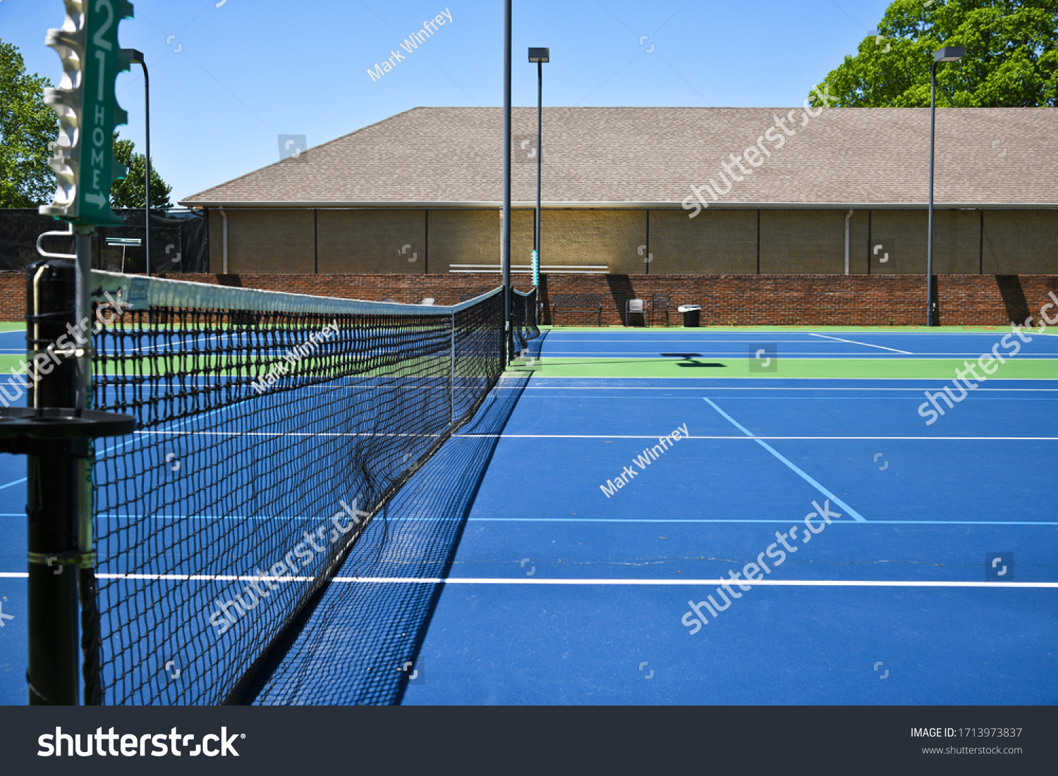 stock-photo-empty-tennis-courts-closed-d