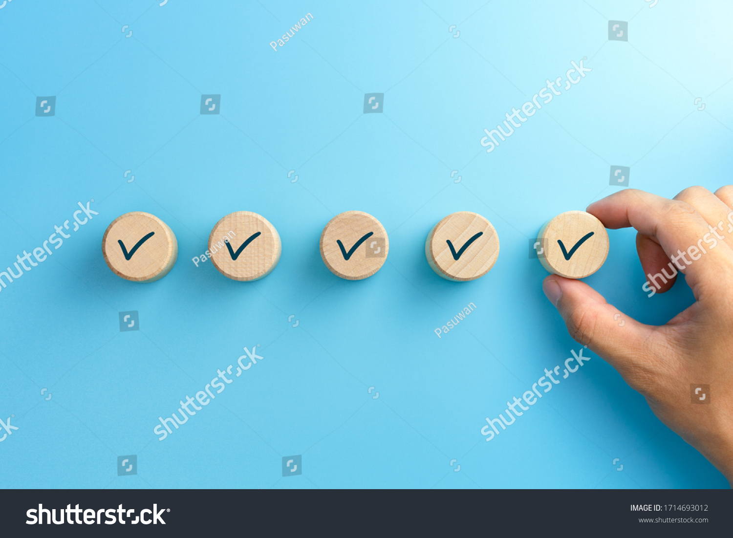 Checklist concept, Check mark on wooden blocks, blue background with copy space #1714693012
