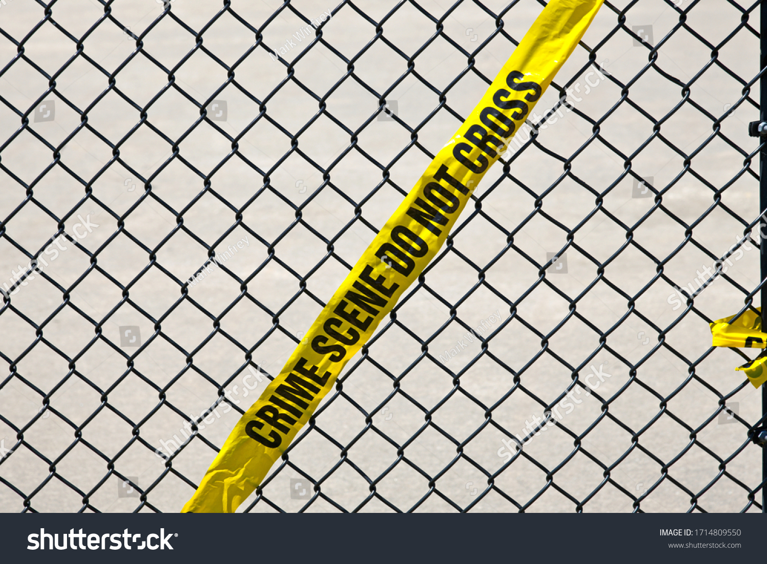 stock-photo-yellow-crime-tape-hanging-on