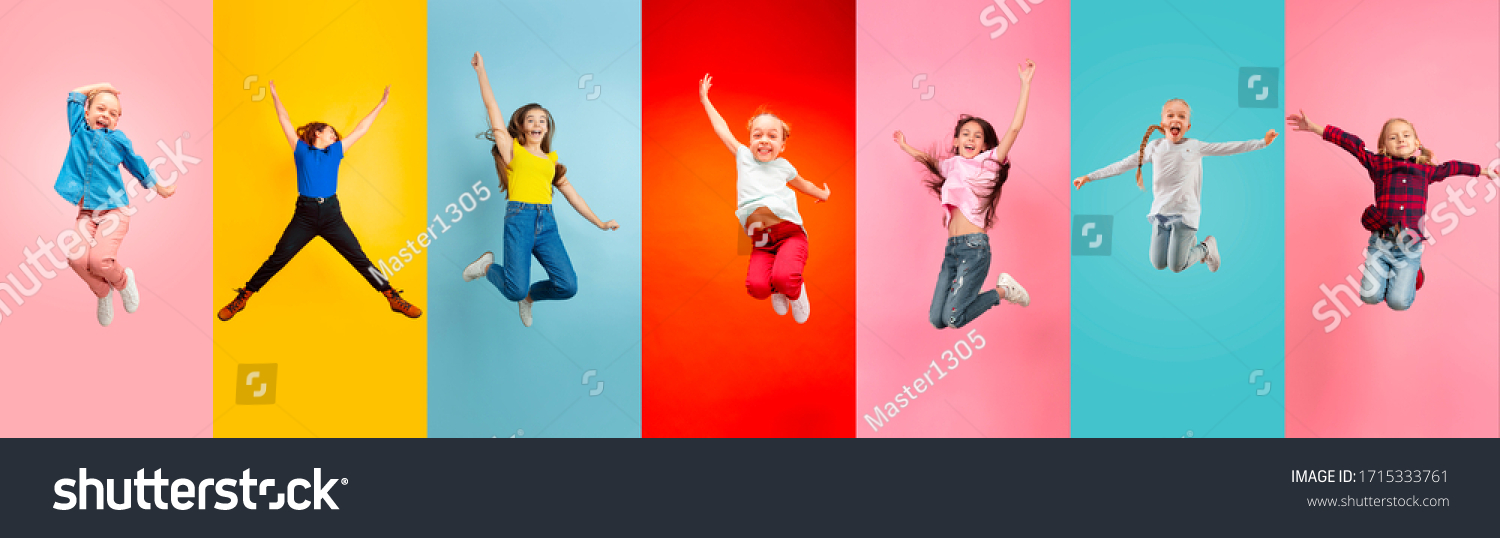 Emotional kids and teens jumping high, look happy, cheerful on multicolored background. Delighted, winning girls. Emotions, facial expression concept. Trendy colors. Creative collage made of 5 models #1715333761