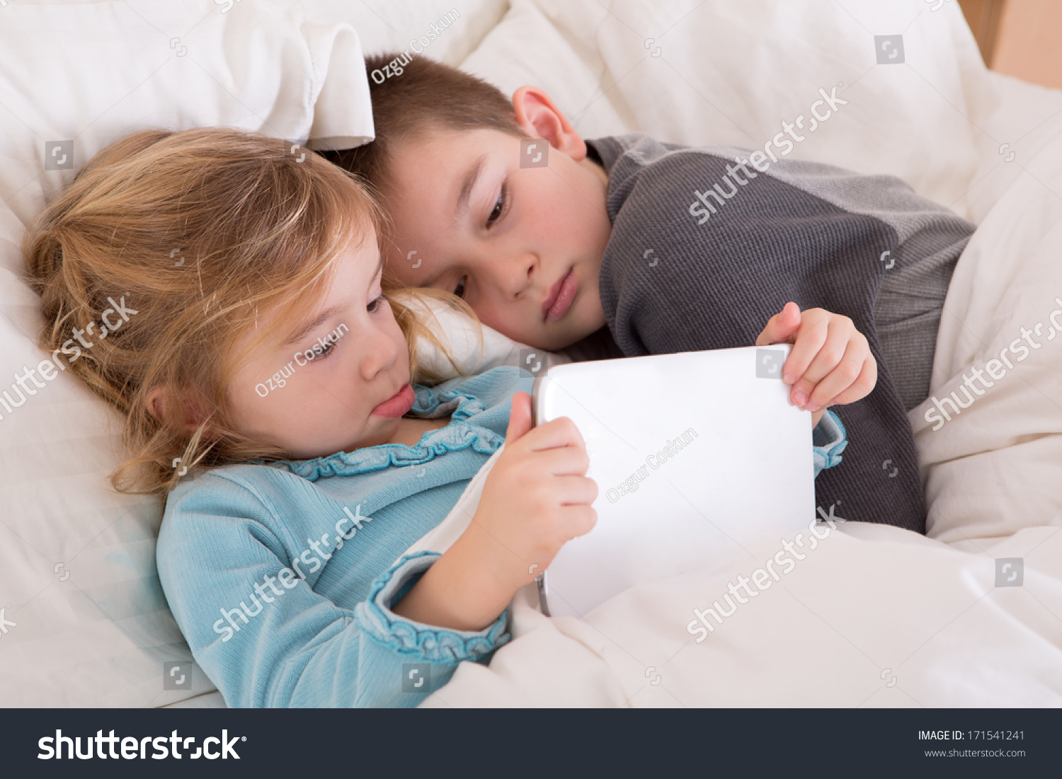 Cute little girl boy reading bedtime stock photo 171541241 for Boys and girls in bed