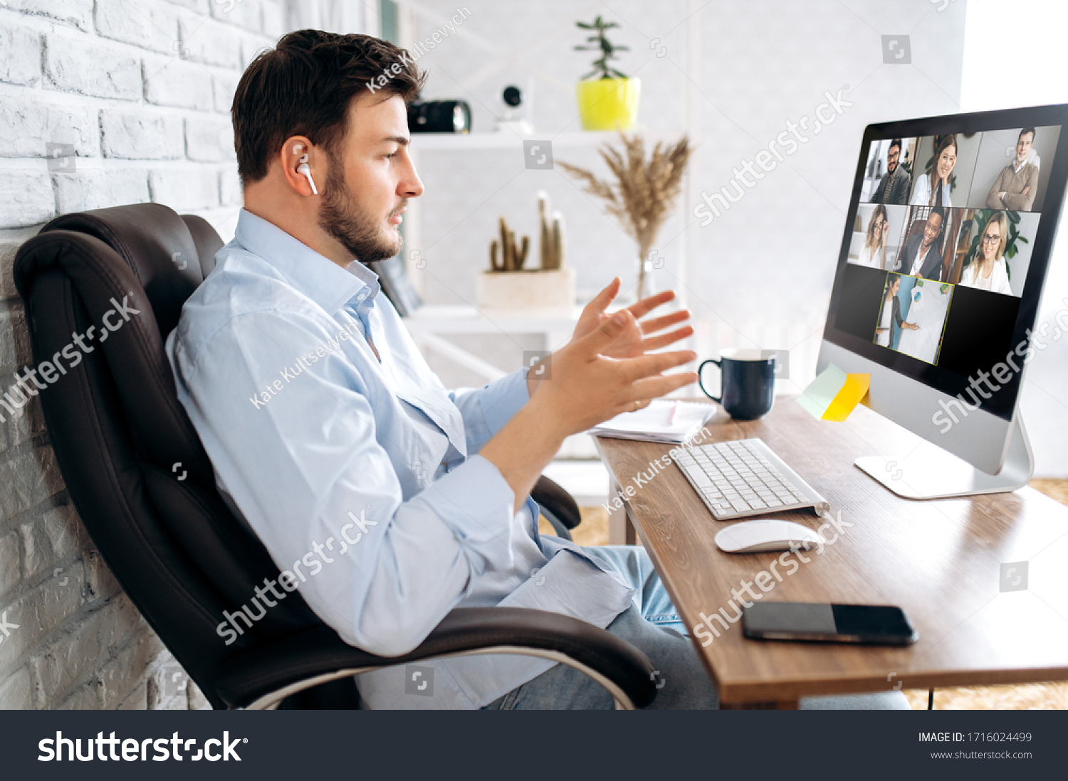 Zoom conference. Business partners communicate via video using laptop. The guy talks with his business partners appearance about plans and strategy. Distant work #1716024499