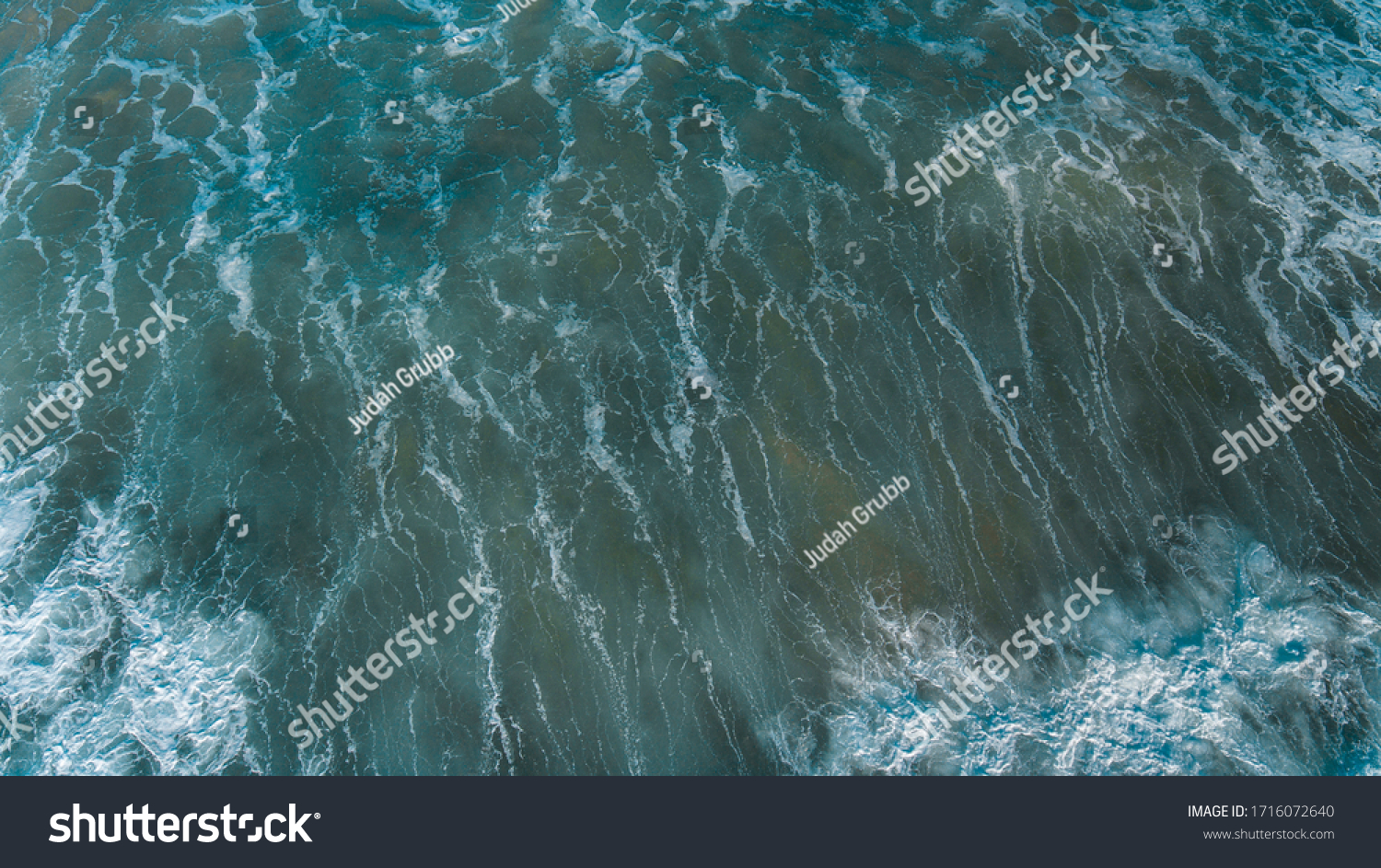 Aerial Views of Coastline and waves and beaches along the Great Ocean Road, Australia #1716072640