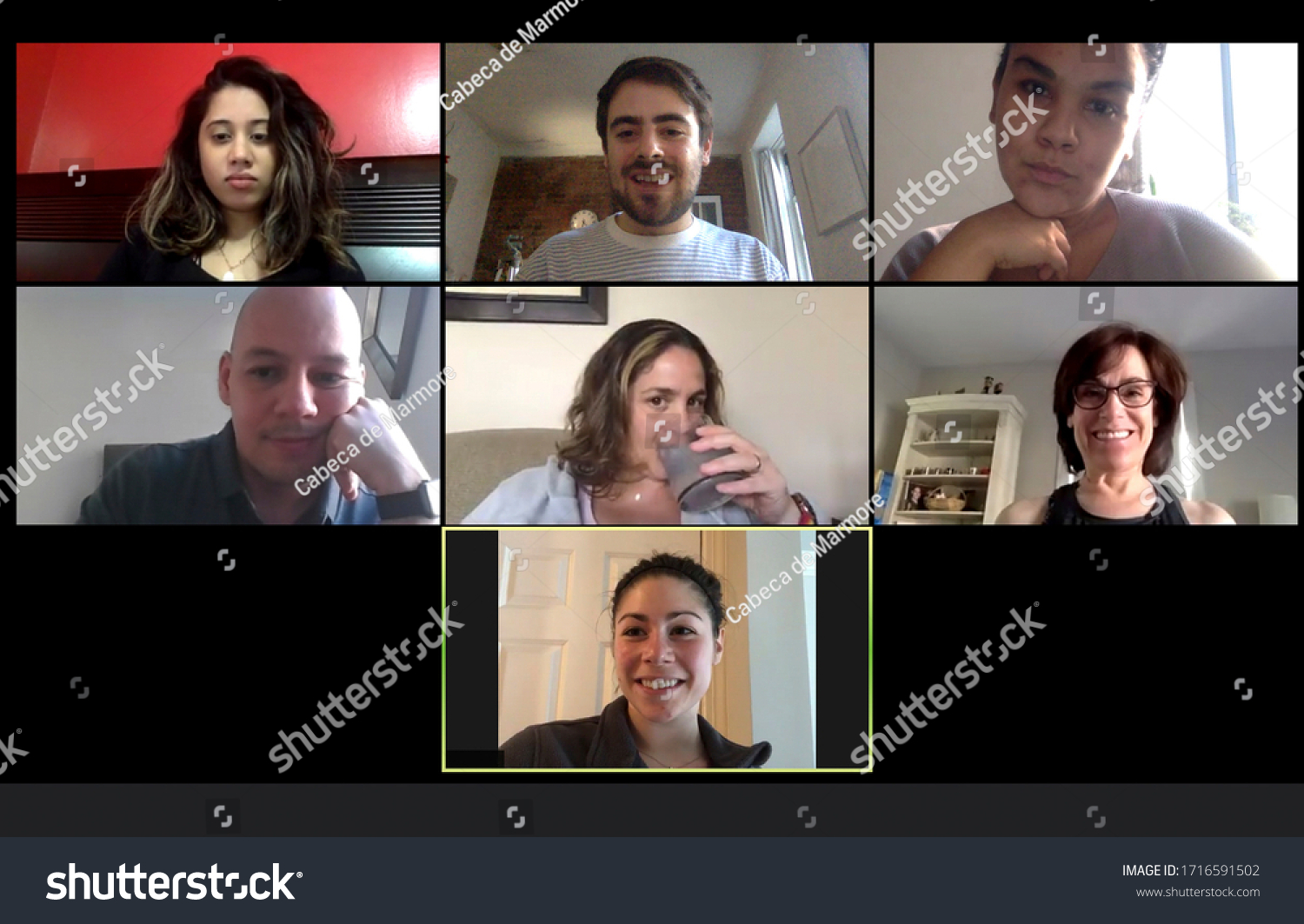 Shot of a screen of teammates doing a virtual conference from their home offices.  Team meeting from home during COVID-19 coronavirus pandemic. #1716591502