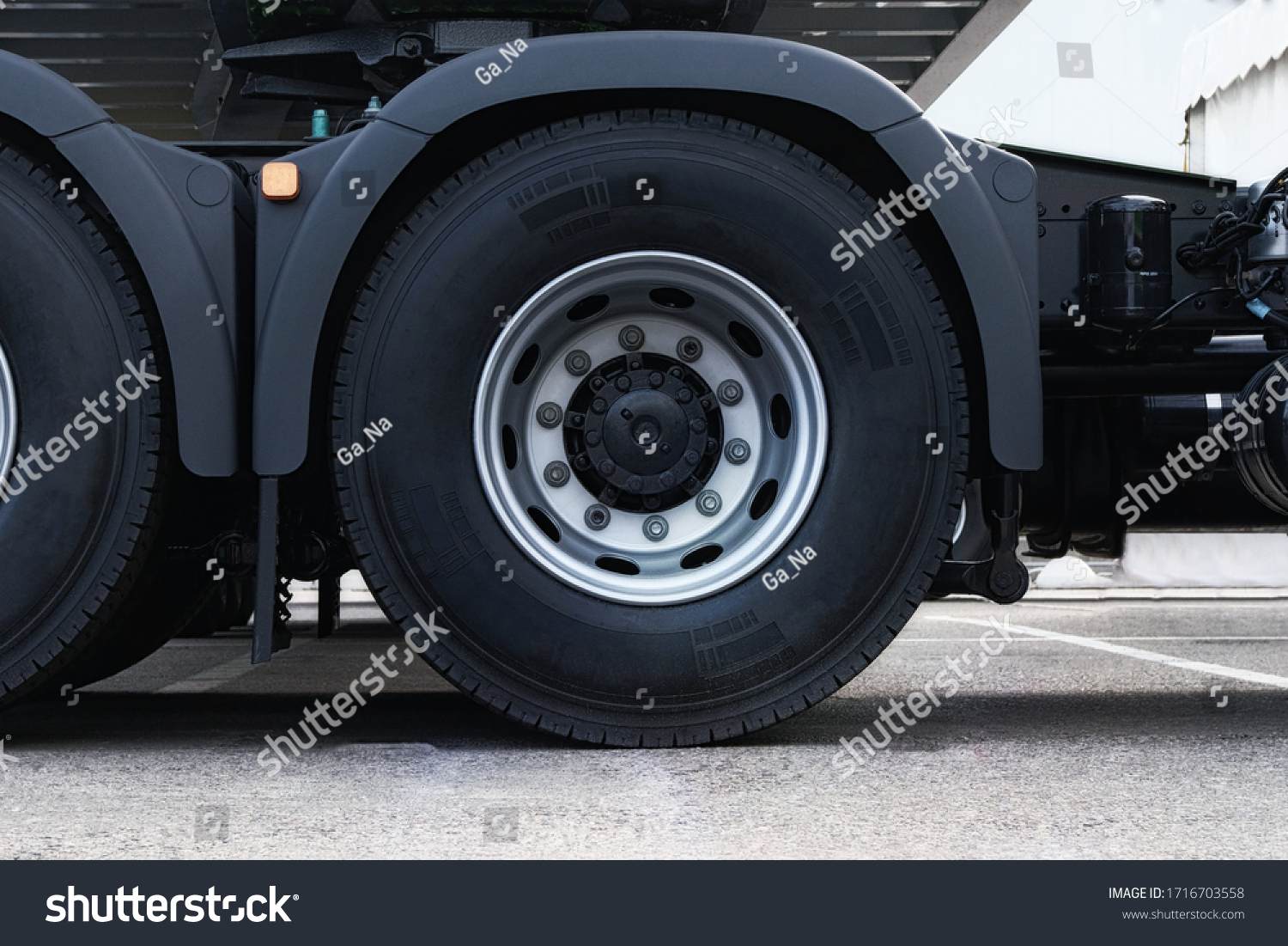 Truck tire, wheel of heavy duty semi truck, close up. Freight industry transport, wheels of modern truck.