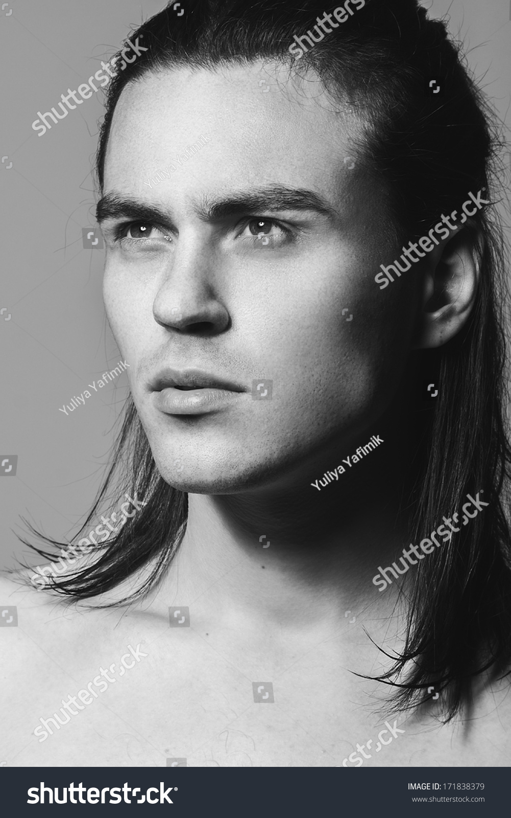 Portrait of a handsome man in studio black and white photographs close up