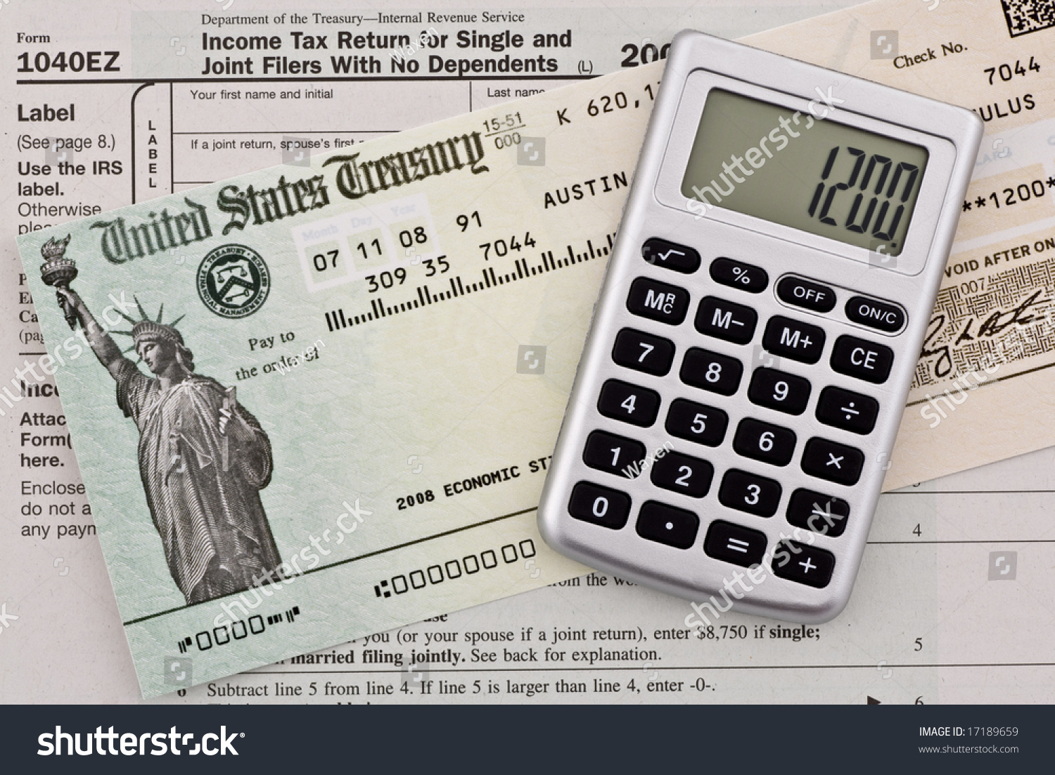 Us government stimulus refund check calculator stock photo 17189659 us government stimulus refund check with calculator and tax form 1040ez numbers have been altered falaconquin
