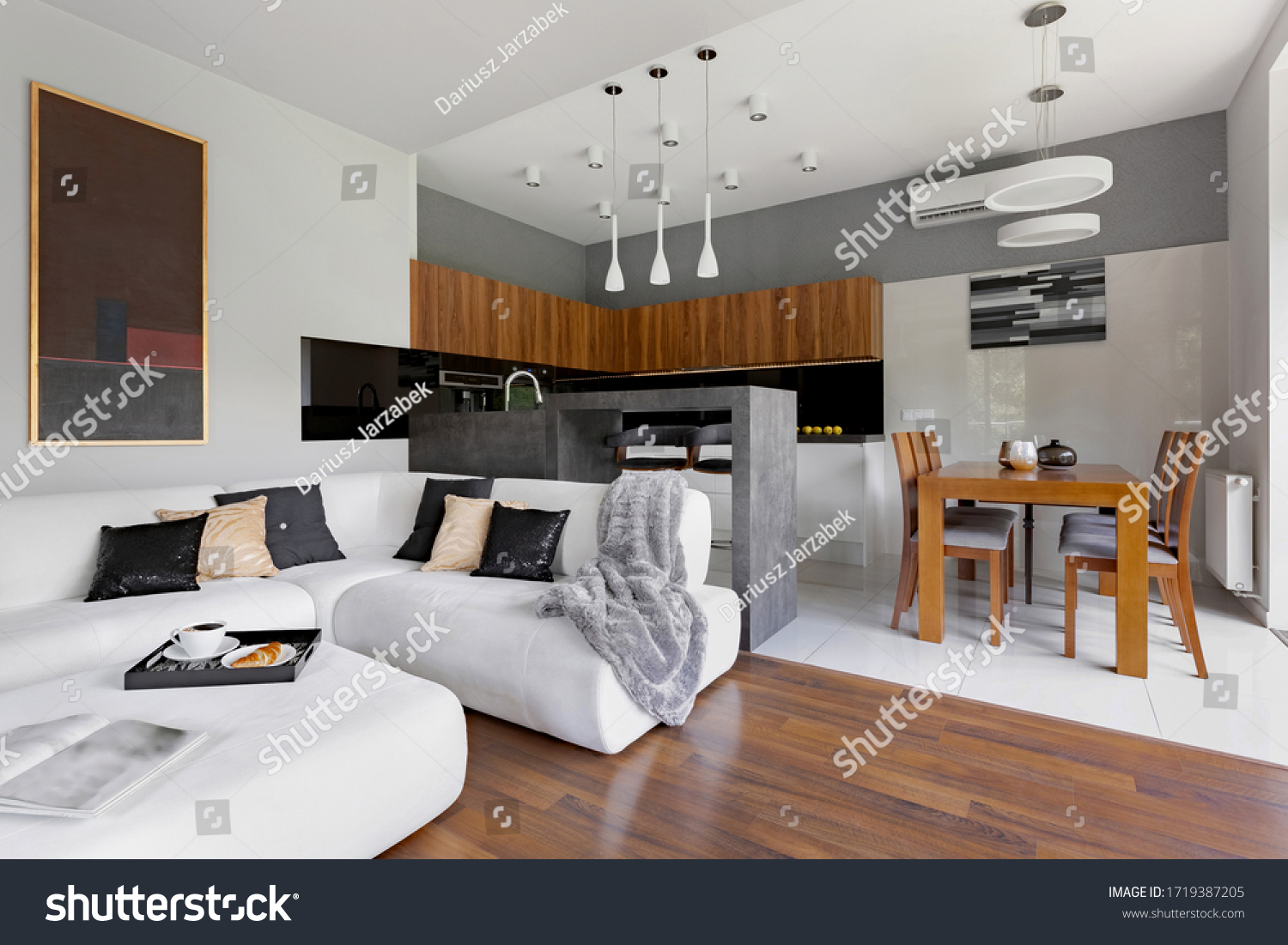 Modern apartment with living room and kitchen with dining table in one space #1719387205
