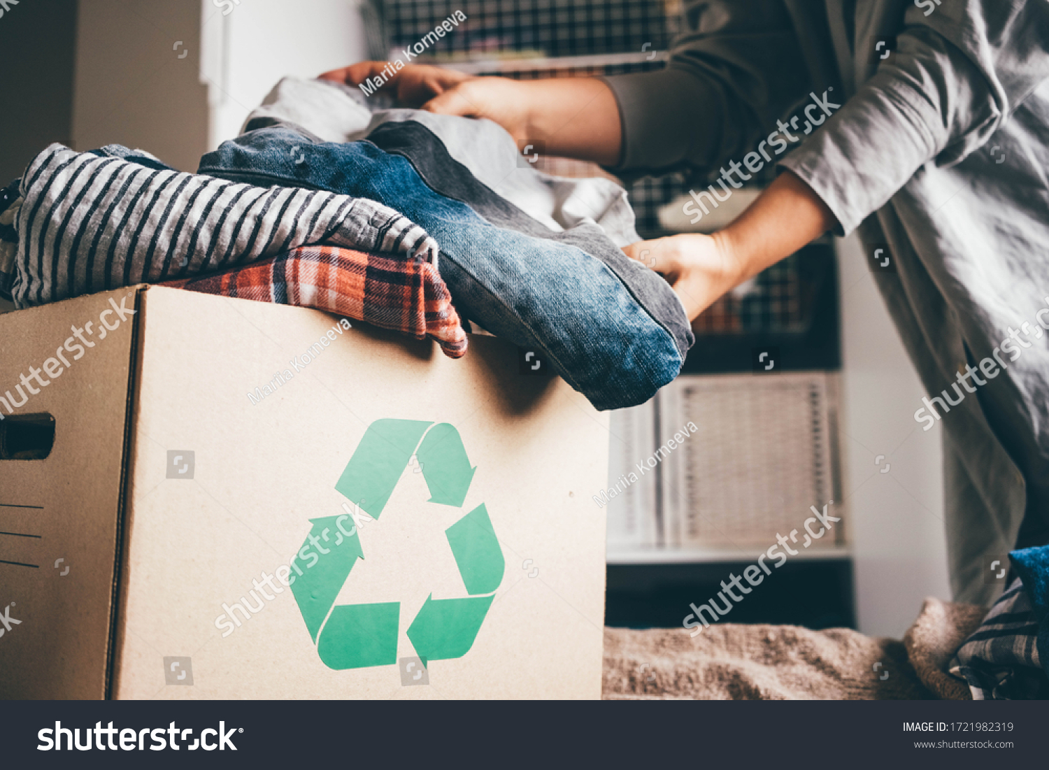 Recycle clothes concept. Recycling box full of clothes. #1721982319