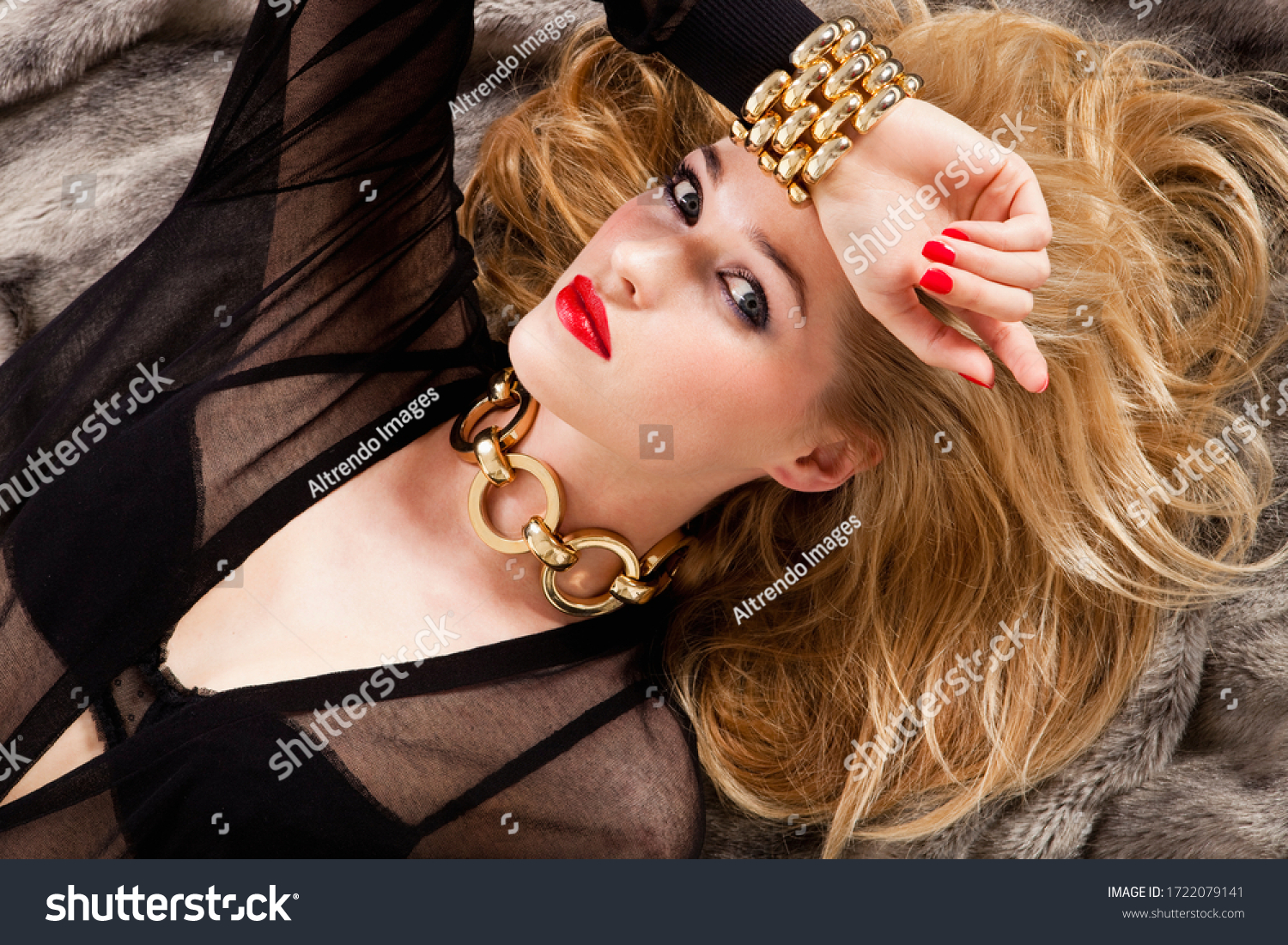 Glamorous young woman lying on bed, portrait #1722079141