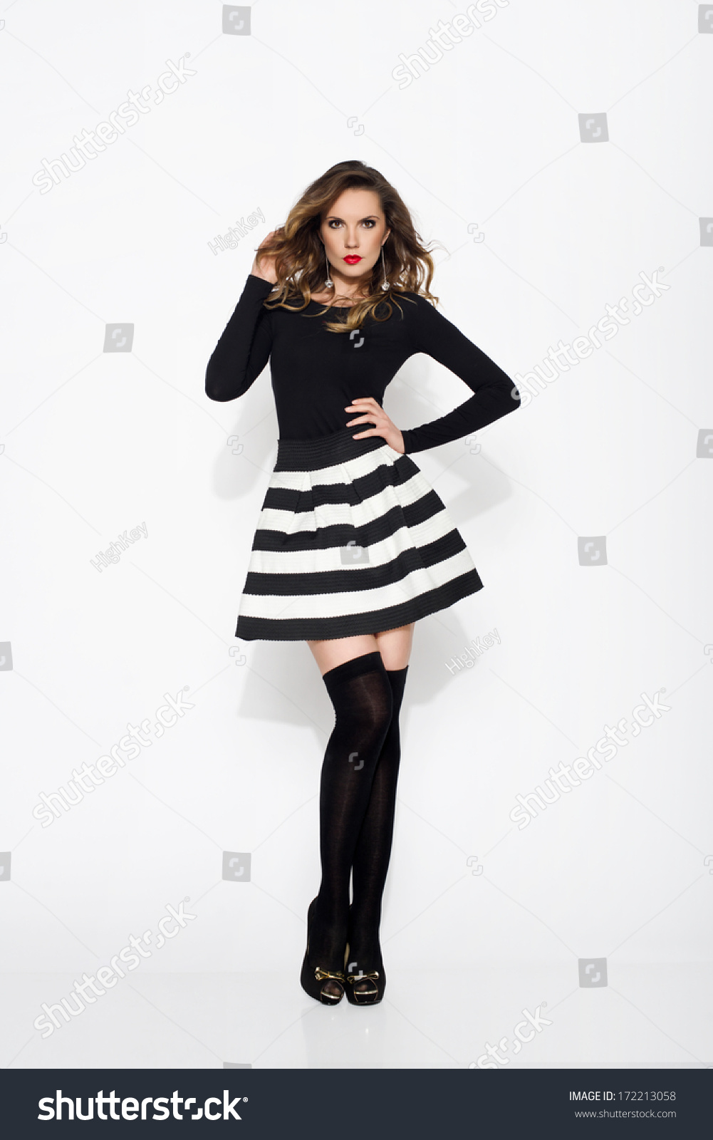 sexy woman wearing mini skirt stockings stock photo (royalty free