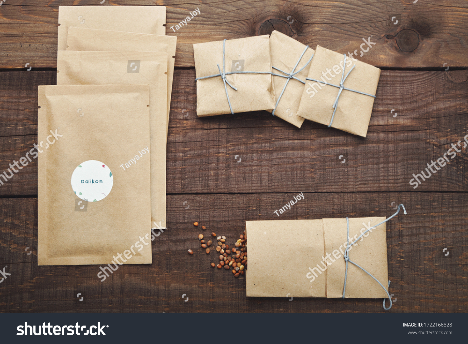 Paper bags with seeds for planting. Wooden table. View from above. #1722166828