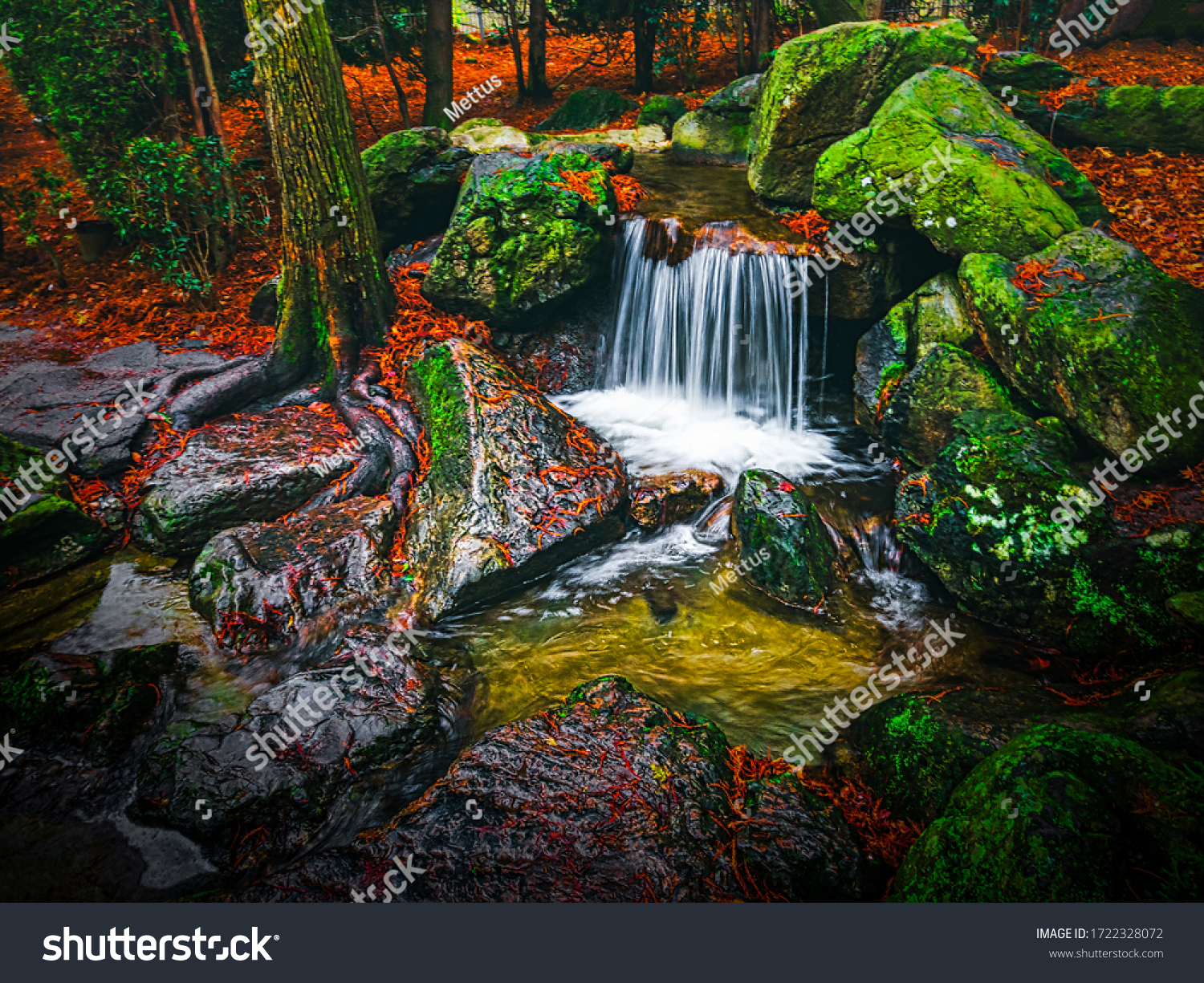 stock-photo-small-nice-waterfall-with-bl