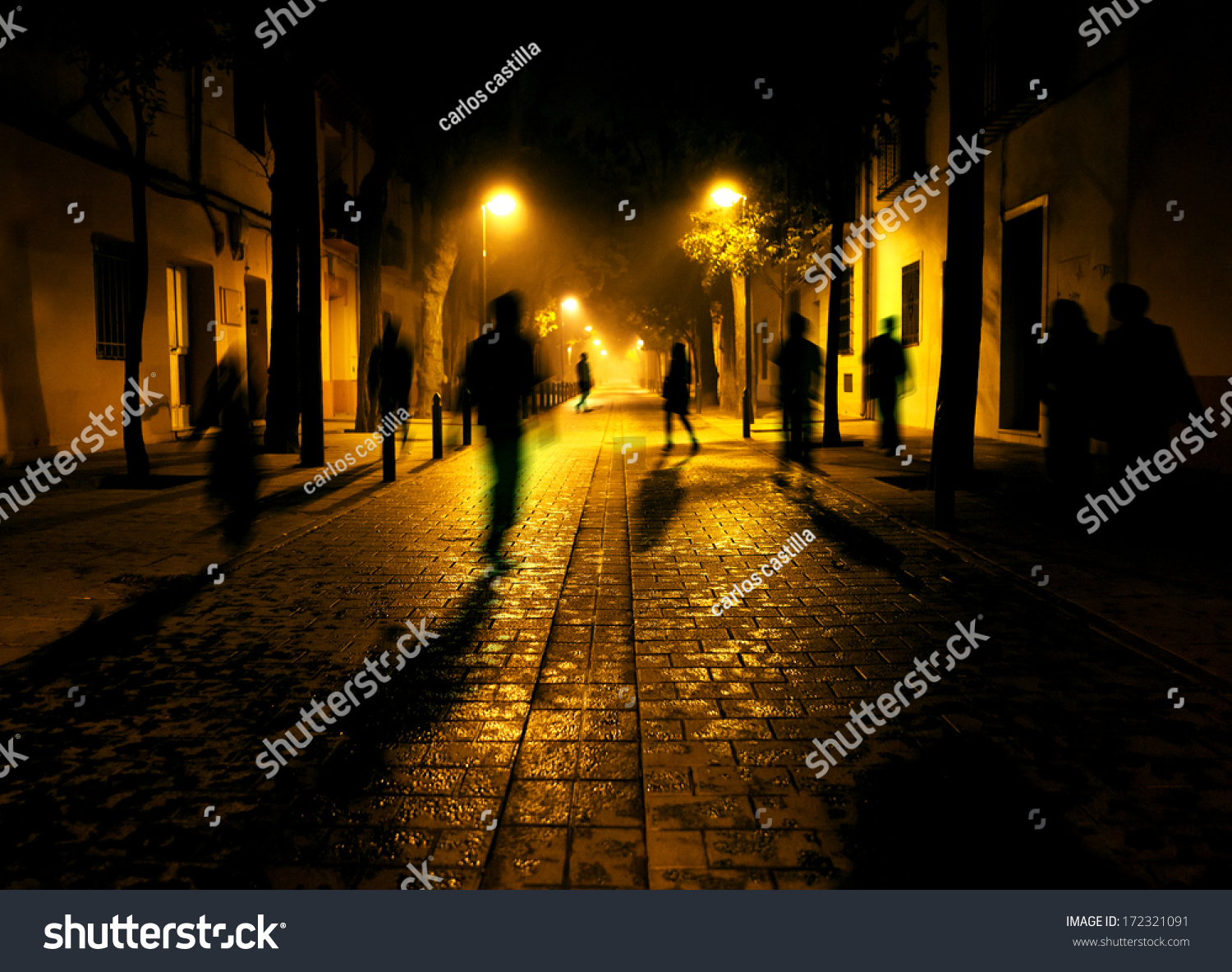 City At Night. Shadows Of People Walking Down The Street ...